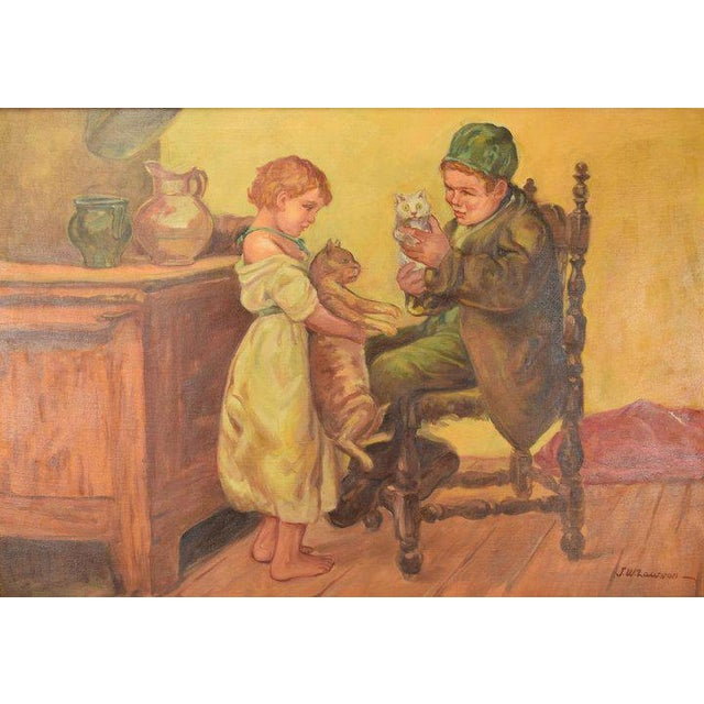 Circa 1920's large oil painting on stretched canvas depicting a young brother and sister playing with cats signed J. W....
