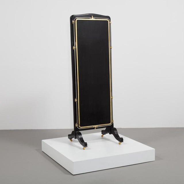 A French Brass And Ebonised Wood Framed Three Fold Mirrored Dressing Screen set on castors circa 1890 Refinished by...