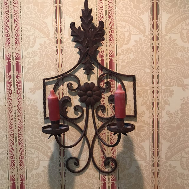 This bronze wrought iron double candleholder is intricate in design. Perfect for a wall that needs a special finish.
