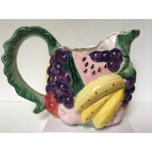 Beautiful and colorful Fitz and Floyd fruit motif hand painted pitcher. This holds 1 and a half quarts of liquid. Very...