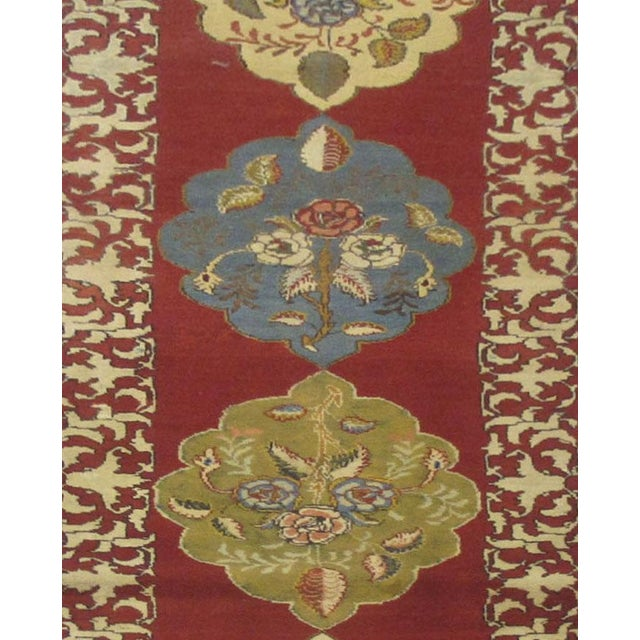 This beautiful rug is hand made, made in Iran. It features a pattern in a vibrant combination of red,...