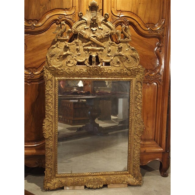 This Period Louis XIV mirror has some of the most elegantly carved motifs. They are motifs such as the lambrequin, the...