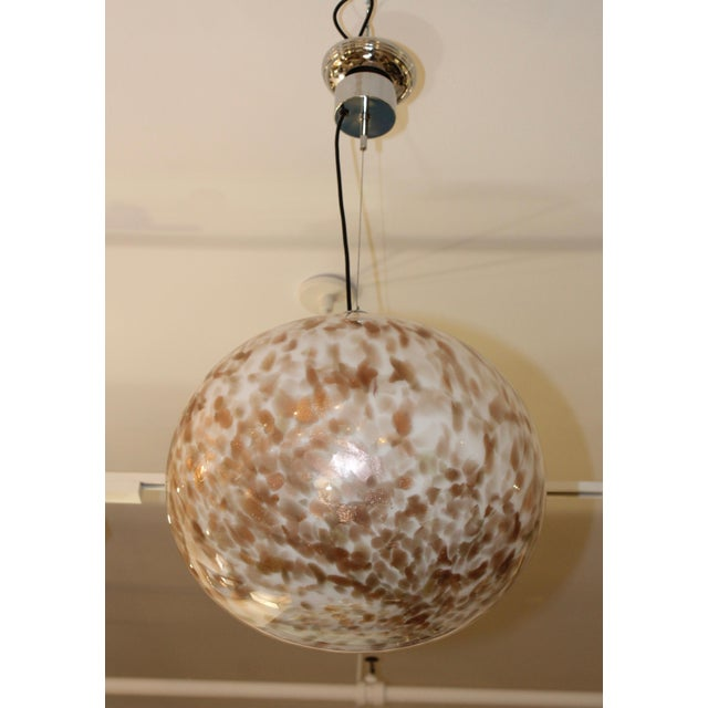 Large 1970s modern Murano glass pendant with chrome hardware.