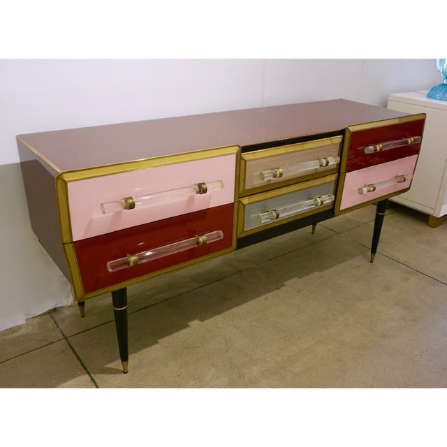 Early 1960s, mid-20th century credenza/chest of drawers, entirely handcrafted in Italy, enticing modern design with arrow...