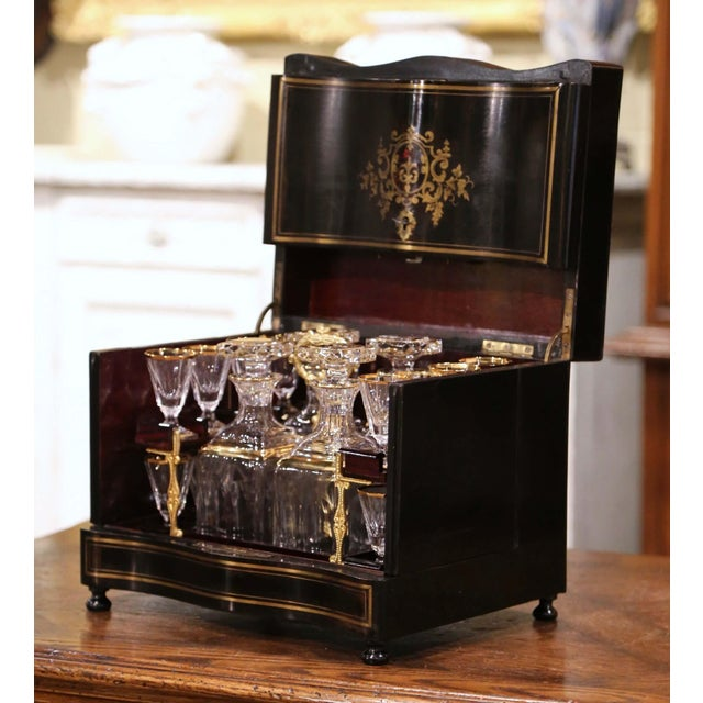 """Create an elegant bar area with this complete antique """"Cave à Liqueur""""! Created in France, circa 1870, the mahogany..."""