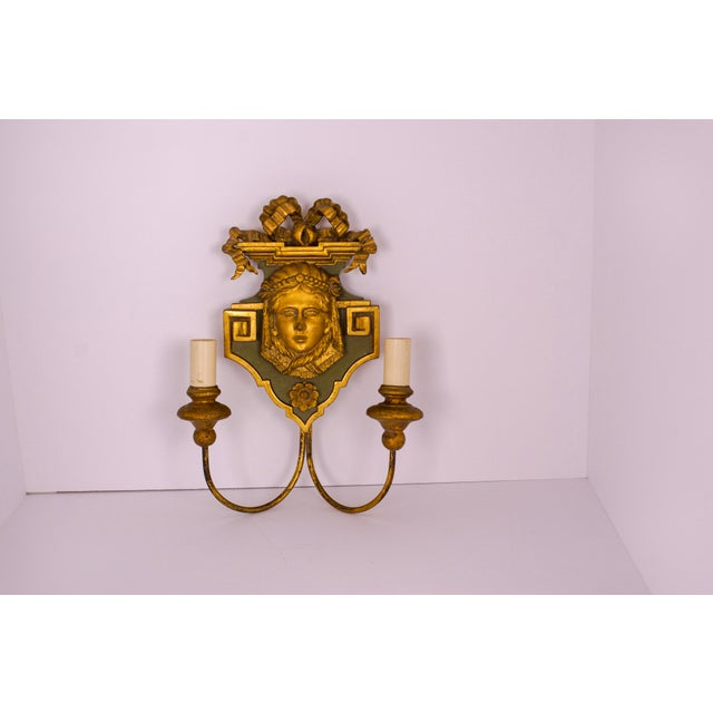 Neoclassical carved-wood sconce with a face of a woman and a bow. Celadon green with gilded accents, the piece has a very...