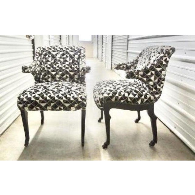Stunning pair of mid-century James Mont inspired ebonized chairs with hoof feet. These unique armchairs have been...
