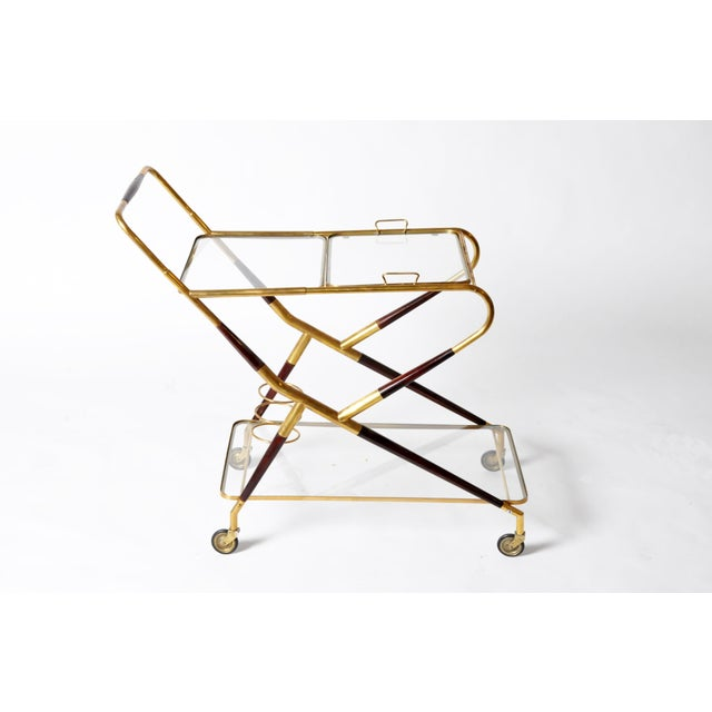 This handsome and streamlined Mid-Century Modern drink trolley looks like it rolled right off the set of Mad Men. The...