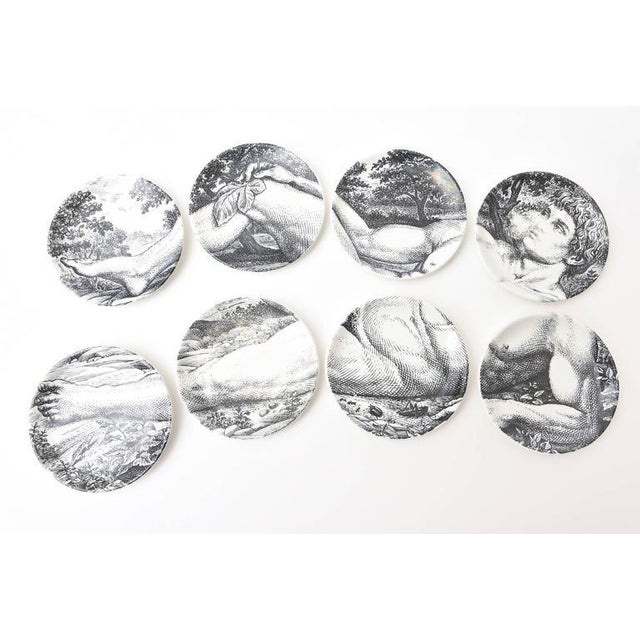 These lovely and interactive set of eight fornasetti porcelain mid-century barware coasters of the allegorical and...