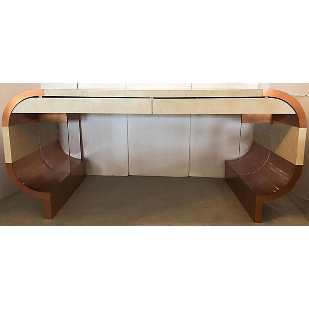 Stunning copper and faux leather mica rounded desk from 1970's. Two drawers. Lucite accents on bottom. Refinished in back...
