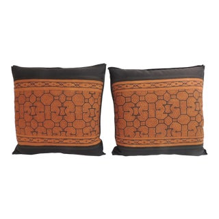 Pair of Graphic Tribal Peruvian Textile in Orange and Black Decorative Pillows For Sale