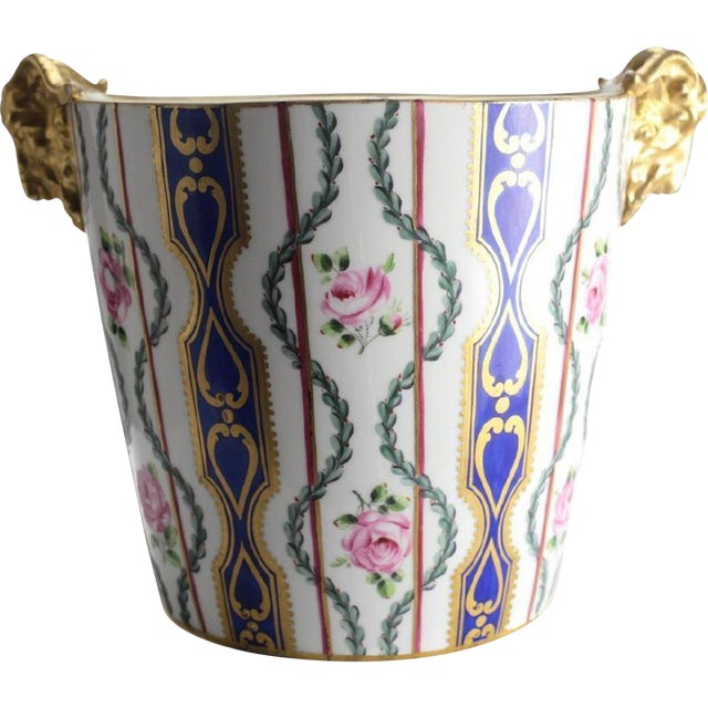 A late 19th Century Sevres porcelain jardiniere cache pot or milk pail with double gilt ram head handles. Hand painted...