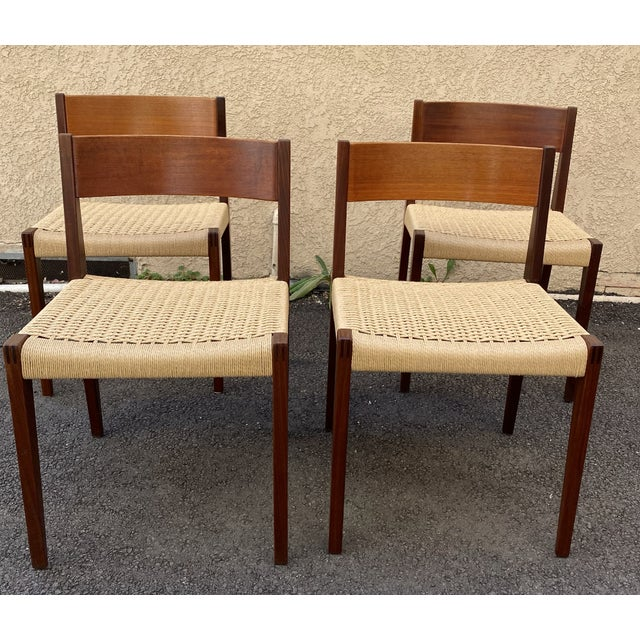 Set of 4 Vintage Danish Teak Rattan Dining Chairs. Made in Denmark with excellent craftsman ship. In original condition.