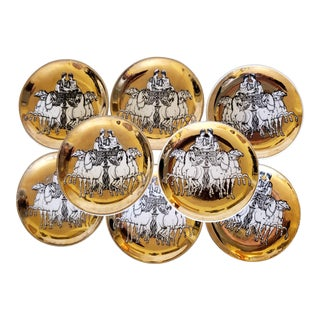 Piero Fornasetti Set of Eight Coasters of Roman Chariots on a Gold Ground With Gold Box, Circa 1960s.. For Sale