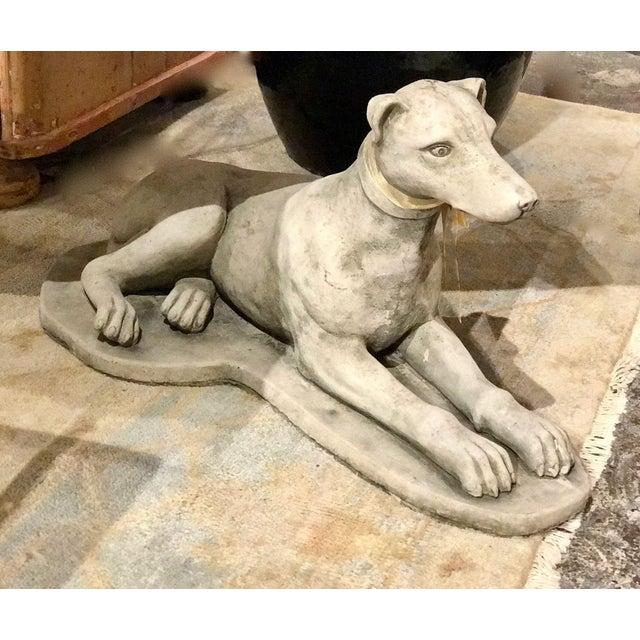 "Vintage European cement dog. Chip on back edge. 27"" Deep x 12"" Wide x 13"" High"