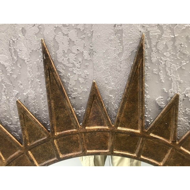 A large giltmetal starburst. Mirror has a great French Modern look. Nice details Great size