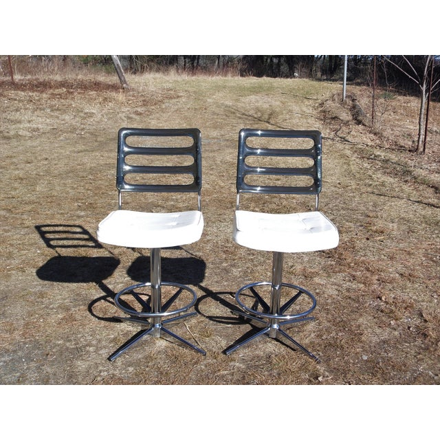 Pair Vintage Mid Century Modern Chromcraft Corp stools have original tufted white vinyl seats with smoked Lucite backs and...