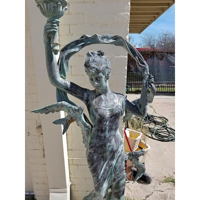 Bronzed Garden Statue of a Lady With Torch & Birds For Sale In Dallas - Image 6 of 7