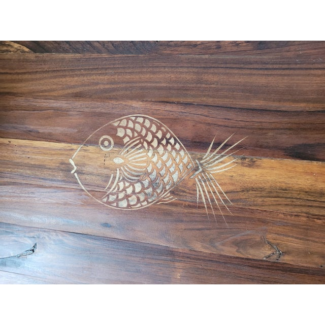 Vintage Brazilian Rosewood coffee table featuring a carved fish. Suitable for outdoor use. Best to maintain finish with...