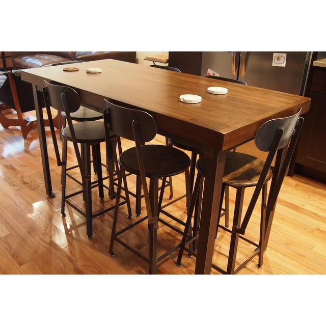 This industrial style counter-height table with 6 stools was custom built as a dining set by Brooklyn Reclamation in 2014....