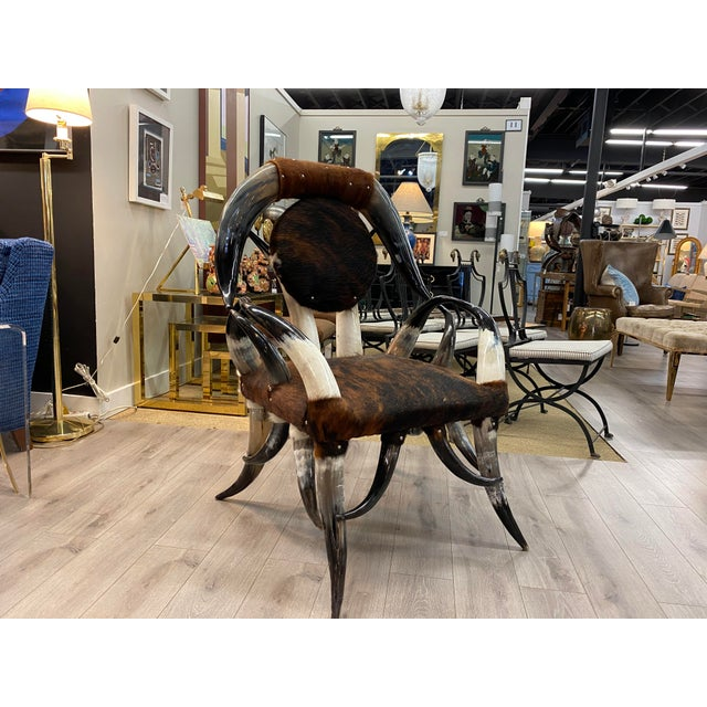 American modern rustic armchair made with a structure made with horns from Texas long-horns and a leather upholstered seat...