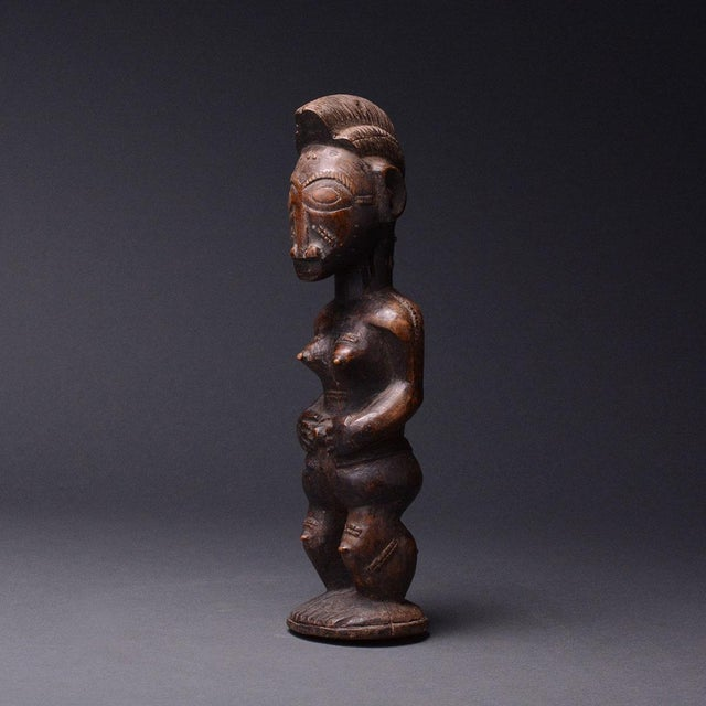 This sculpture appears to be related to baule works representing spouses from the spiritual world, called blolo bla (blolo...