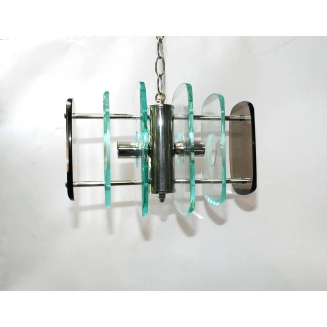 Vintage Italian pendant with clear and smoky beveled glass rectangular panels, mounted on chrome frame / In the style of...