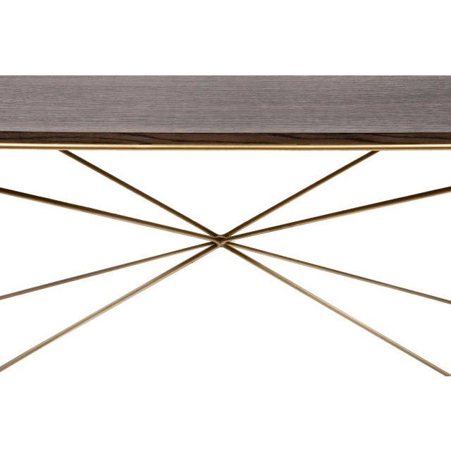 Robert Console Table with greyed oak top and satin brass base. Custom orders have a lead time of 10-12 weeks FOB NYC. Lead...