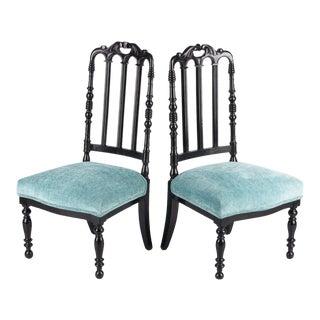 "Pair of Napoleon III Ebonized ""Chauffeuses"" Low Chairs, 1870s"