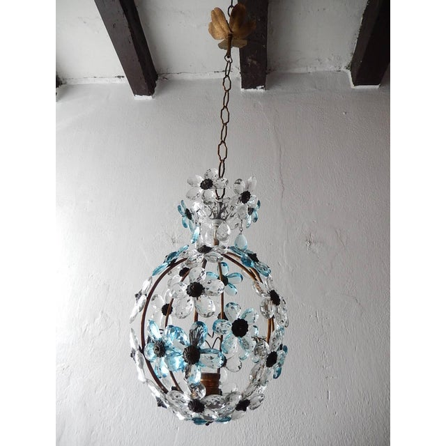 Housing one light. Rewired and ready to hang. Clear and aqua blue crystal prisms. Murano glass and crystal bobèche on top...