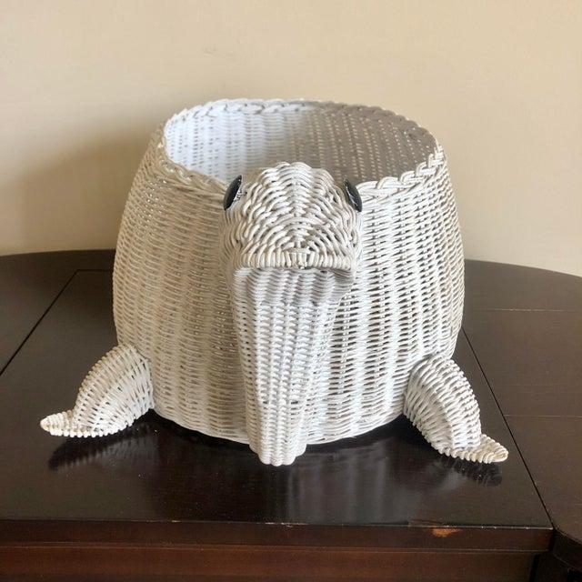 Vintage white wicket turtle basket.