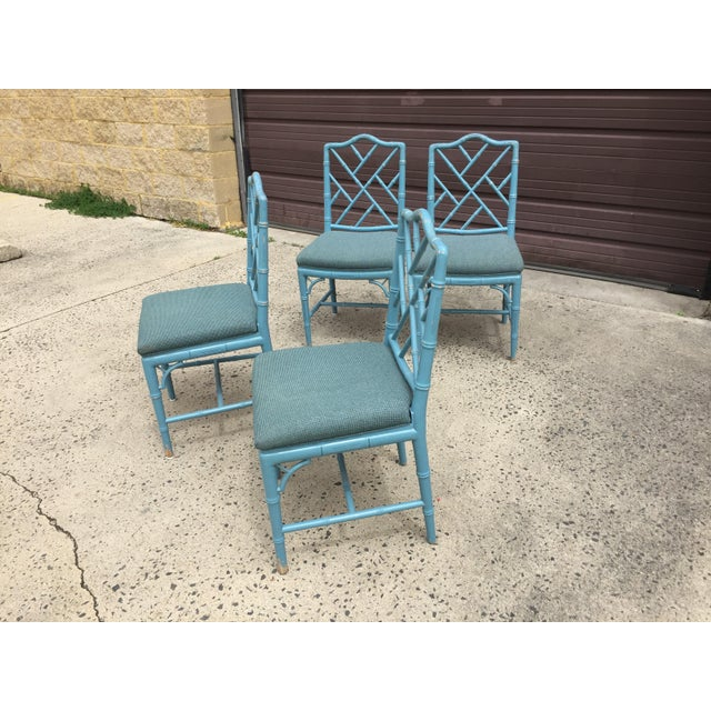 Fabulous set of 4 vintage Chinese Chippendale-style faux bamboo carved wood dining chairs with upholstered seats in a...