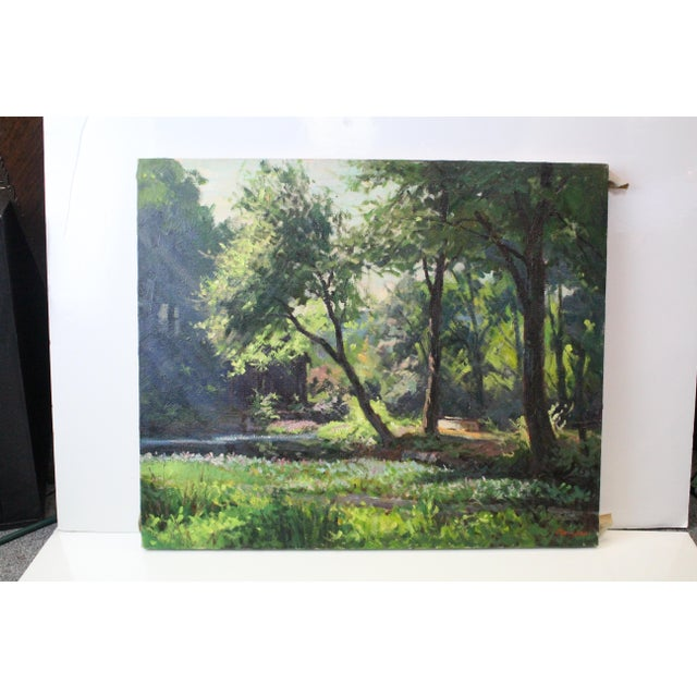 Vibrant Foster Caddell oil on canvas of a sunny spring forest in hues of green with excellent lighting details.