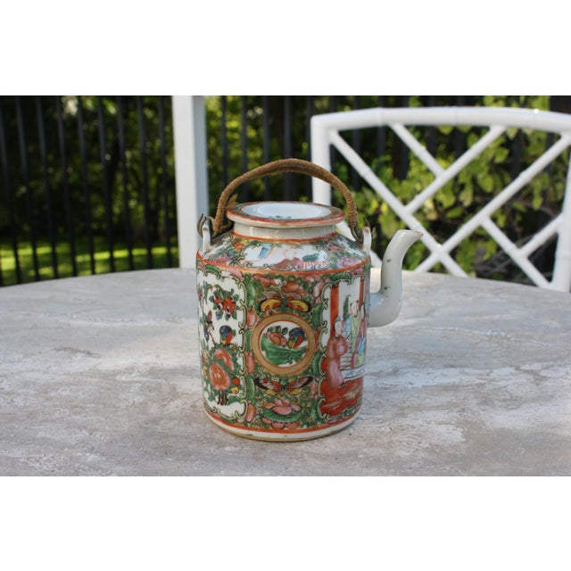 This charming Chinese Export Rose Medallion teapot comes with lid and twine-wrapped wire handles. CONDITION: Good antique...