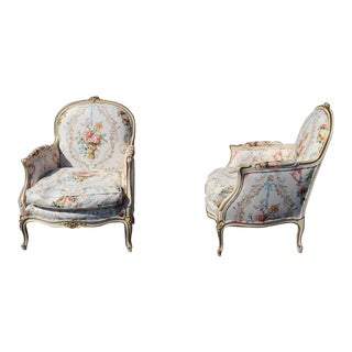Pair of French Painted Carved Louis XV Style Bergere Chairs For Sale