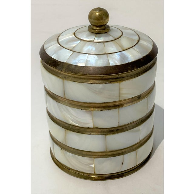 Charming trinket box accessory in mother-of-pearl and brass.