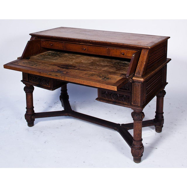 Gothic looking carved drop down desk that is drop dead gorgeous.
