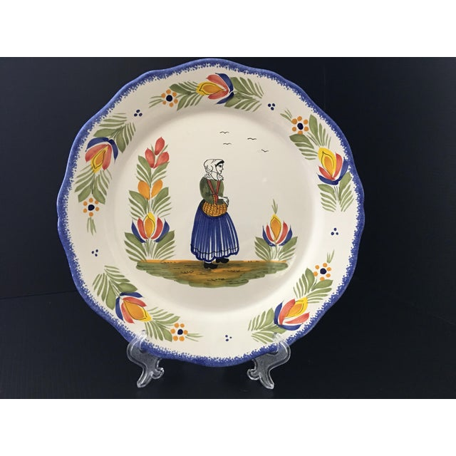 Very charming French faience HB Quimper plate with scalloped hand-painted Couronnes border and the figure of a Bretonne...