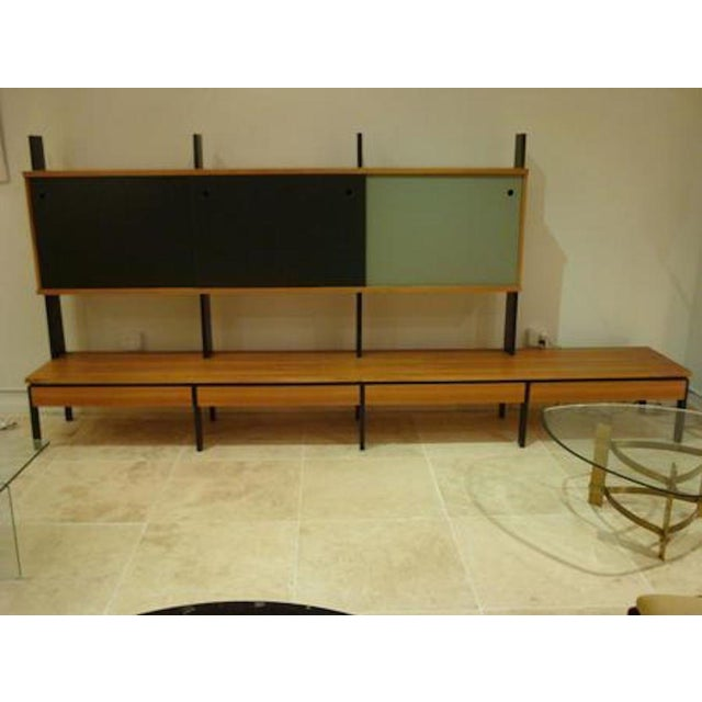 Long mid century modernist wall unit featuring a body in European birch with a long low shelf with bottom drawers, black...