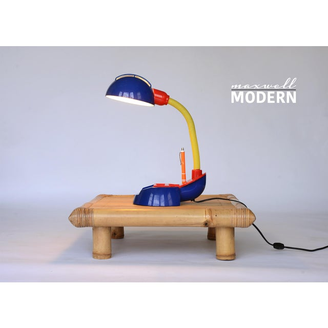 Awesome rare vintage tricolor plastic desk lamp. This fun whimsical design recalls the strong Memphis influence of the 80s...