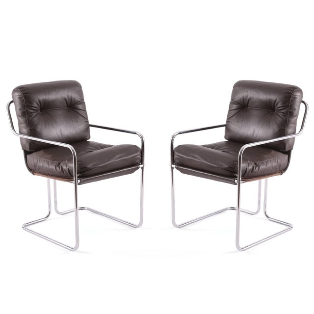 Set of four Guido Faleschini for Pace leather and chrome dining chairs, circa early 1970s. These all original examples...
