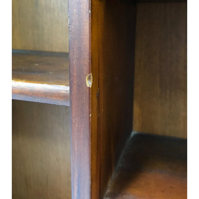Playhouse wood bookcase with wall hanging hardware. It has the original finish but could be easily painted for a sweet...