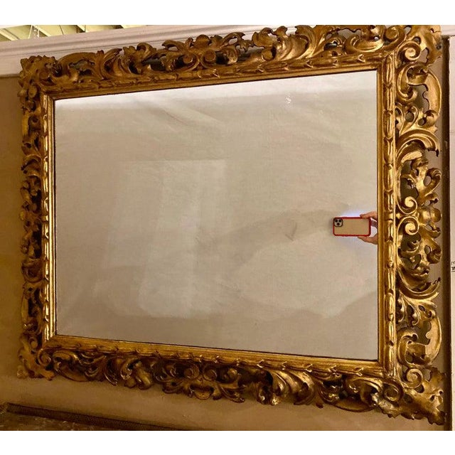 A gilt gesso decorated carved wall / console mirror having scroll and leaf form carvings in very nice condition.