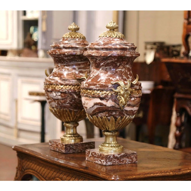 Crafted in France, circa 1870, these antique vases are made of marble and sit on square bases. The substantial 19th...