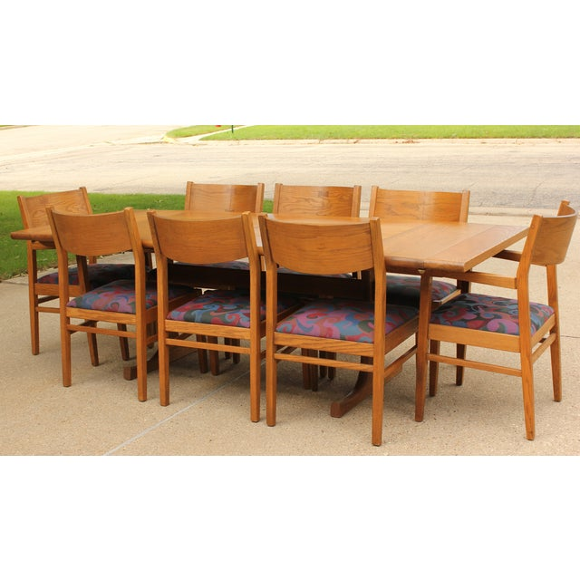 """Vintage Conant Ball oak dining table with 8 matching upholstered chairs. This set has bowtie inlay and two 12"""" leaves..."""
