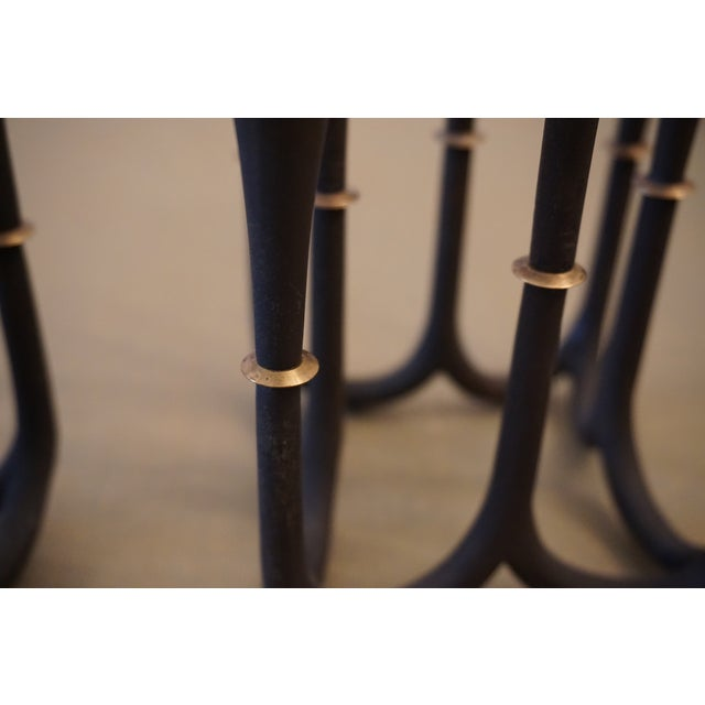 These beautiful candelabras have eight arms, each with a collar of angled brass. Designed for thin tapers, the were...