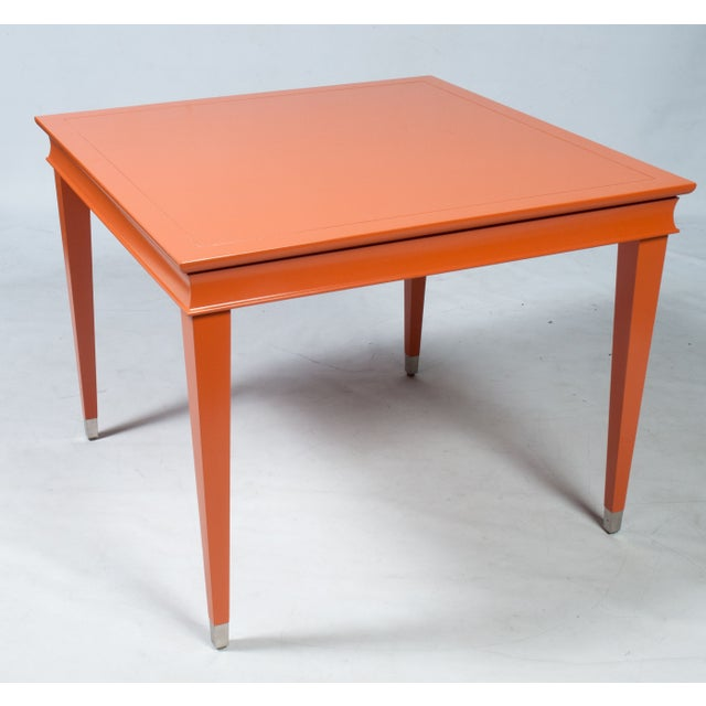 This juicy orange game table will add just the right amount of pop to any room in your home. It features a lacquered wood...