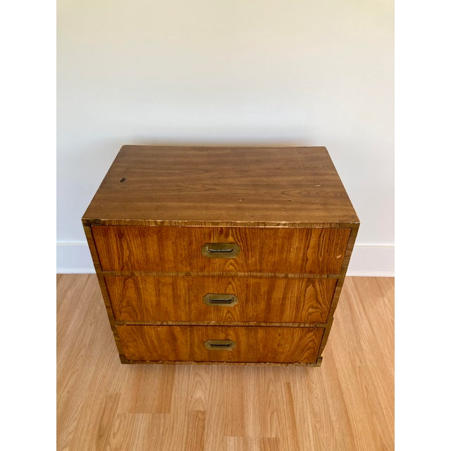 Dixie Campaigner 3 drawer dresser or nightstand with inset brass drawer pulls and corners. Solid construction with...