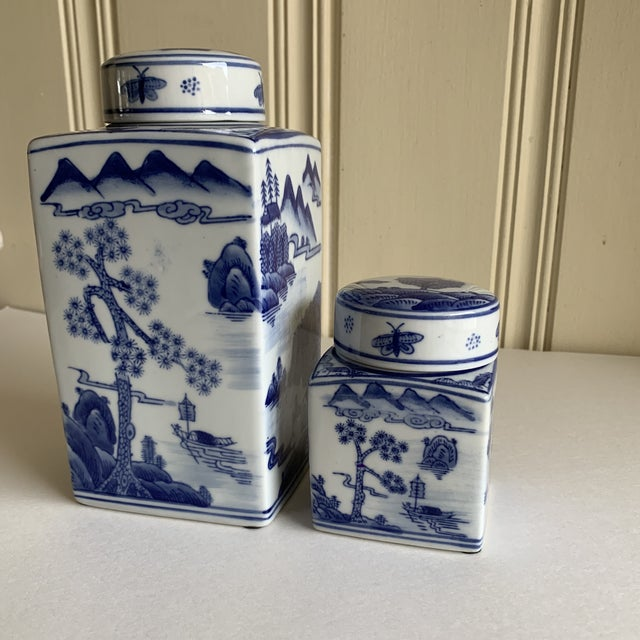 Beautiful set of two classic blue and white ceramic Asian chinoiserie style ginger jars or tea canisters. Lovely design of...