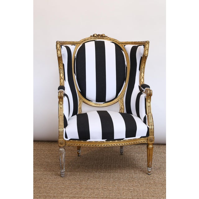 Antique Gold Gilded Arm Chair, upholstered in black and white stripe.